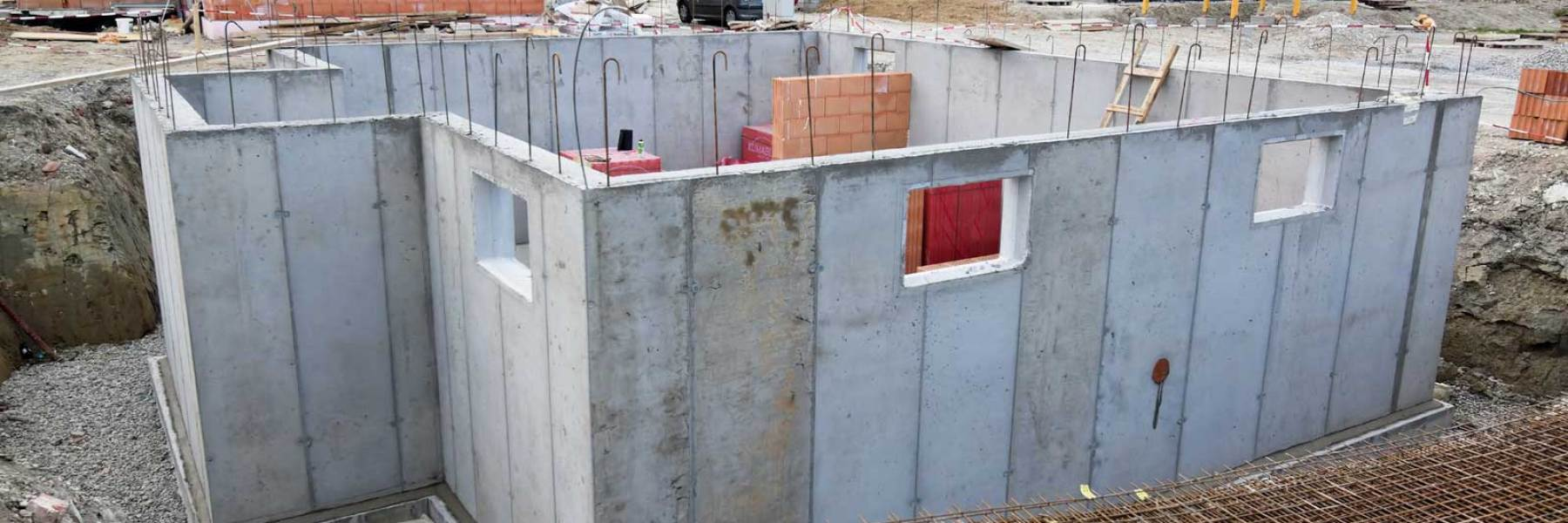 Cropped concrete forming housing west for Housing foundations